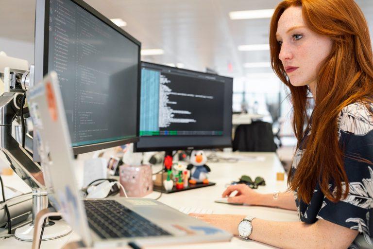 woman working in multiple screen