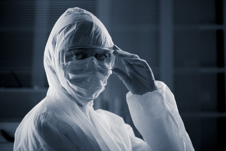 wearing complete PPE set