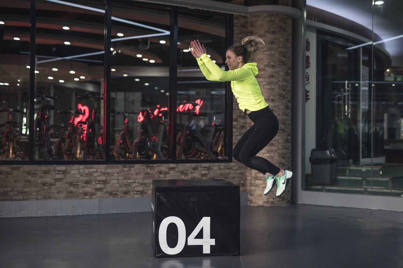 woman in sports apparel jumping