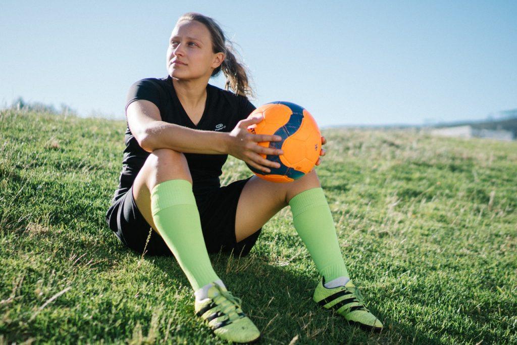woman in soccer uniform